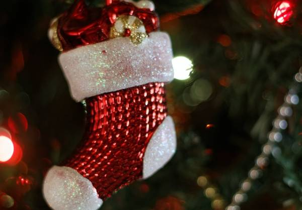 Christmas stockings are a long-standing holiday tradition, but why do we hang socks by the fireplace for Santa to fill?