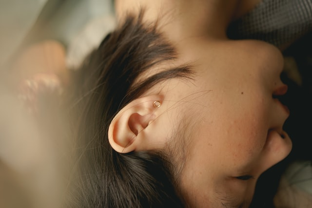 Ear health and hearing loss have massive impacts on overall quality of life. Photo by Jessica Flavia on Unsplash.